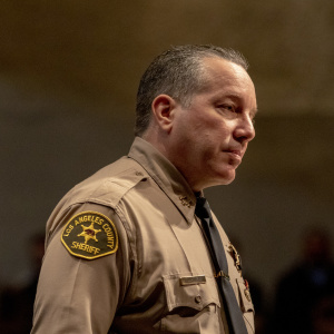 Why Is LA County Sheriff Villanueva Fighting So Hard to Keep A Deputy Accused Of Domestic Abuse?