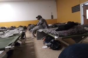 'Everybody Is Crammed In.' Scenes From A Homeless Shelter During A Pandemic