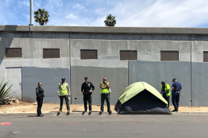 Why Armed Cops Are The First Responders For The Homelessness Crisis