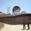 Photos: A Street Artist Just Put Up This Giant Portrait Looking Over The U.S./Mexico Border Wall