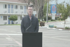 What's Behind Gov. Newsom's Harsh Words For Cities Blocking Hotels For Homeless People