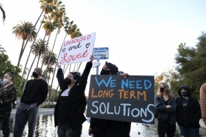 Protesters At Echo Park Confront LAPD Over Plans To Clear Encampment Of Unhoused Residents