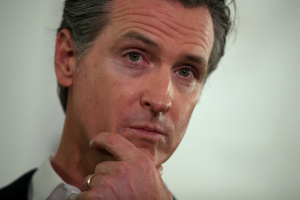 5 Key Questions About Newsom's Head-Scratching Choice Of Blue Shield To Lead Vaccination Push