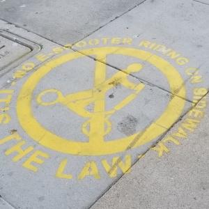 These Sidewalk Stencils Aim To Curb LA Scooter Scofflaws' Bad Riding