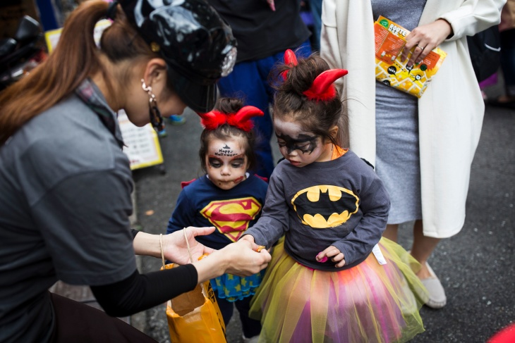 children in costumes receive candy during a halloween parade in tokyo on october 29 2016 photo by behrouz mehriafpgetty images