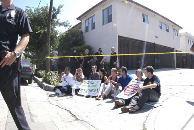 Protesters sitting in the alley near the medical marijuana clinic