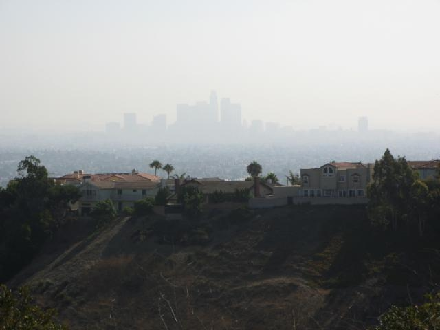 hillside houses and hazy downtown