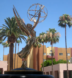 An enormous Emmy Statue sits atop a fountain in the courtyard of the Academy