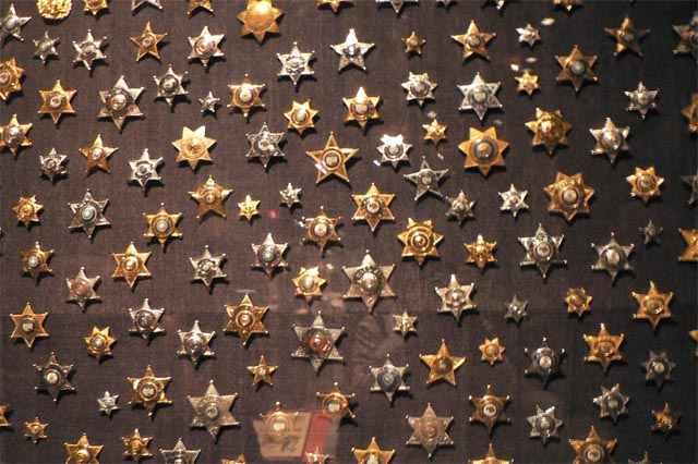la sheriffs badges or notches on a wall