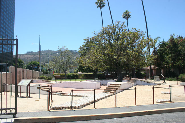 The original stone of Campo de Cahuenga in the foreground.