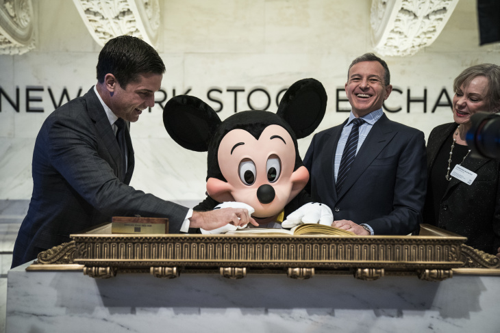 Robert Iger, Disney's former CEO, next to Mickey Mouse and other Disney employees