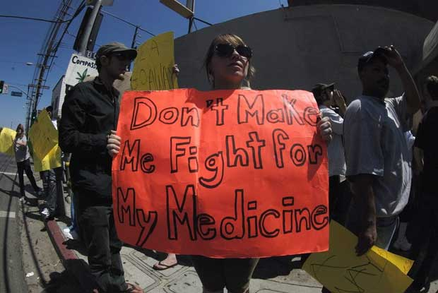 Sign reads 'Don't Make Me Fight For My Medicine'