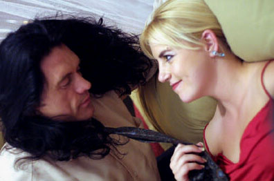 Johnny (Tommy Wiseau) and Lisa (Juliette Danielle) get it on in The Room