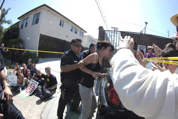 A woman being arrested