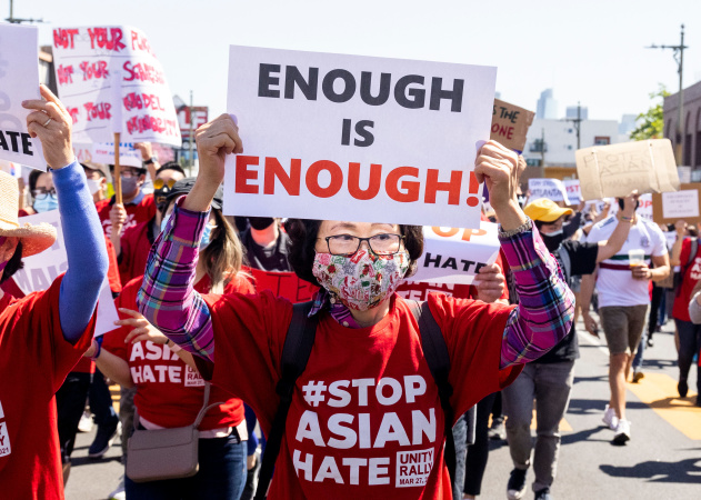 'Enough Is Enough.' Scenes From Saturday's 'Stop Asian Hate' March In LA's Koreatown