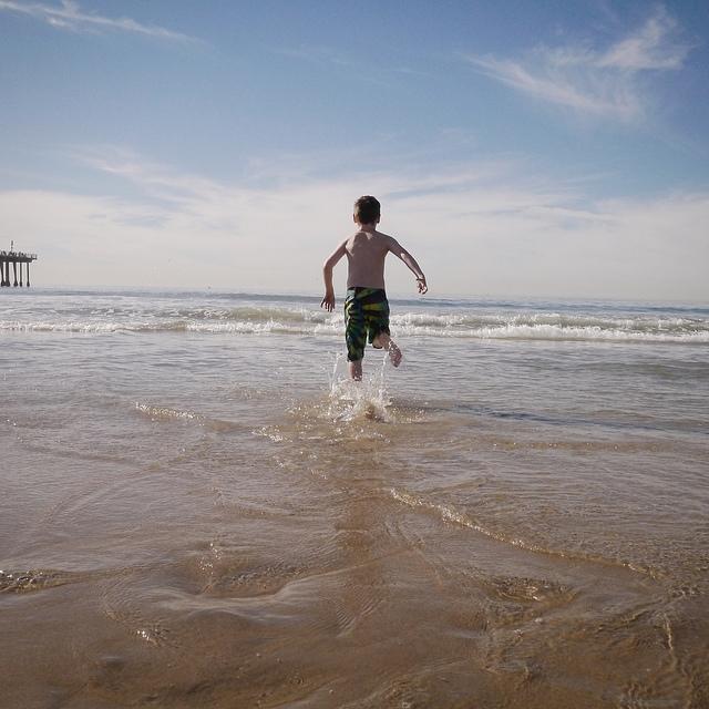 kid frolics in december surf.jpg