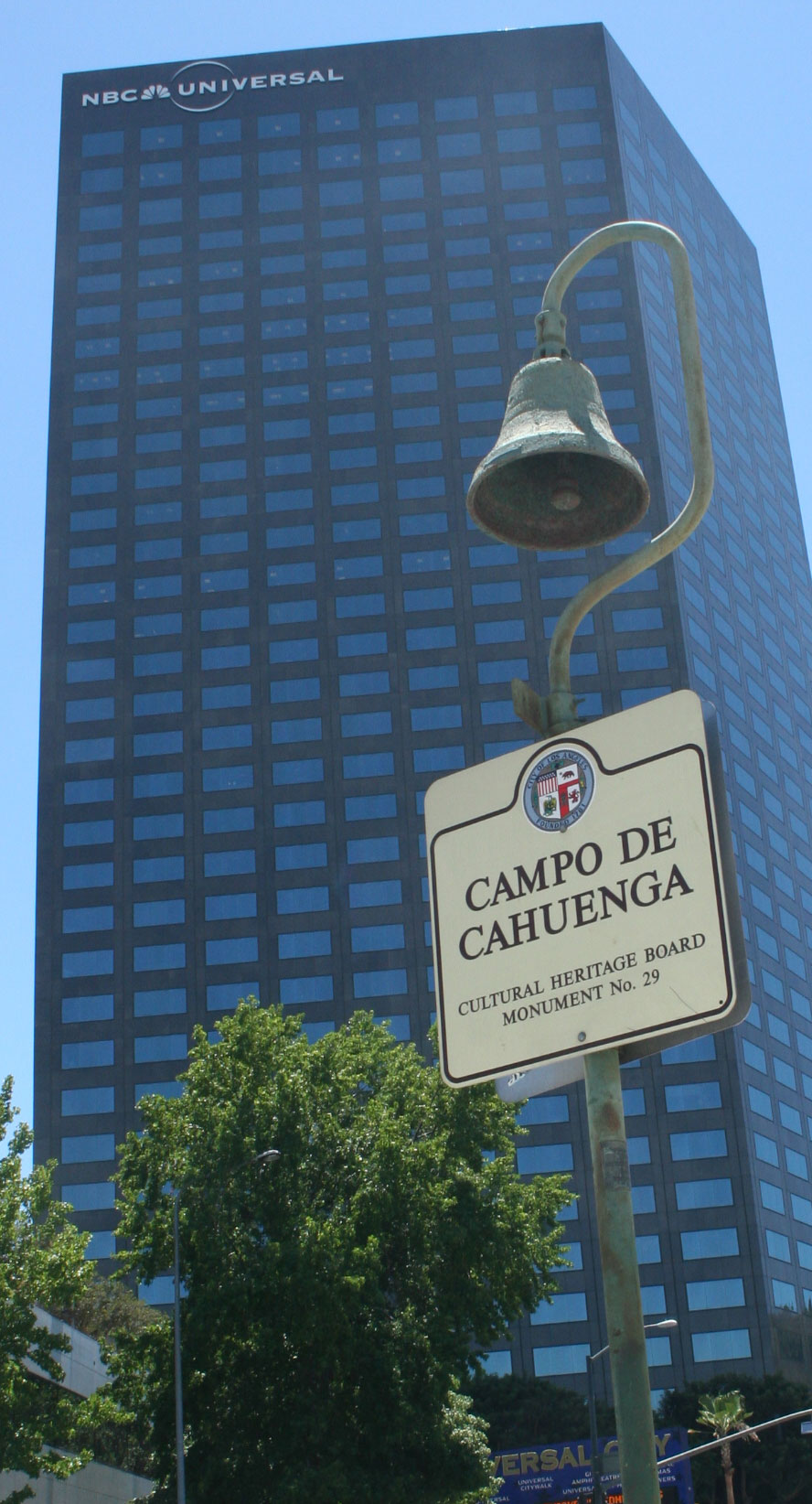 El Camino Real Bell in front of the Universal tower.