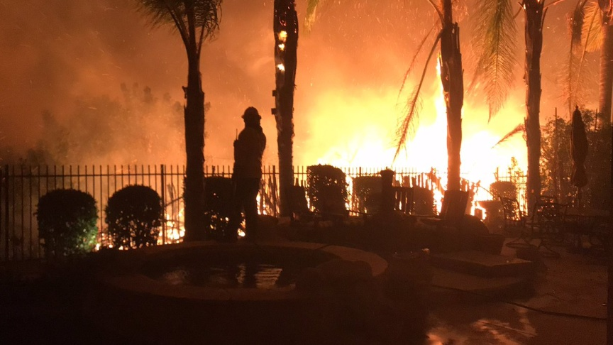 California wildfire turns deadly, leaves nine dead Photogallery